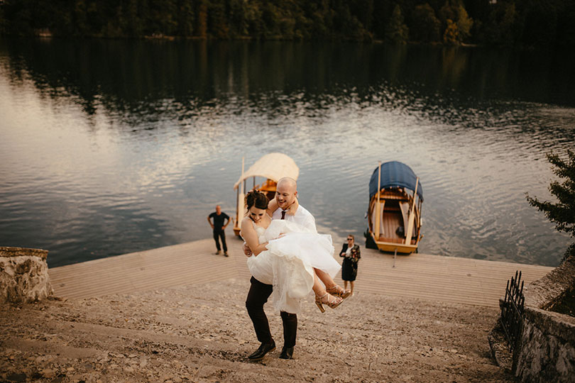 During their Bled wedding The Groom has to carry the Bride on 99 stairs