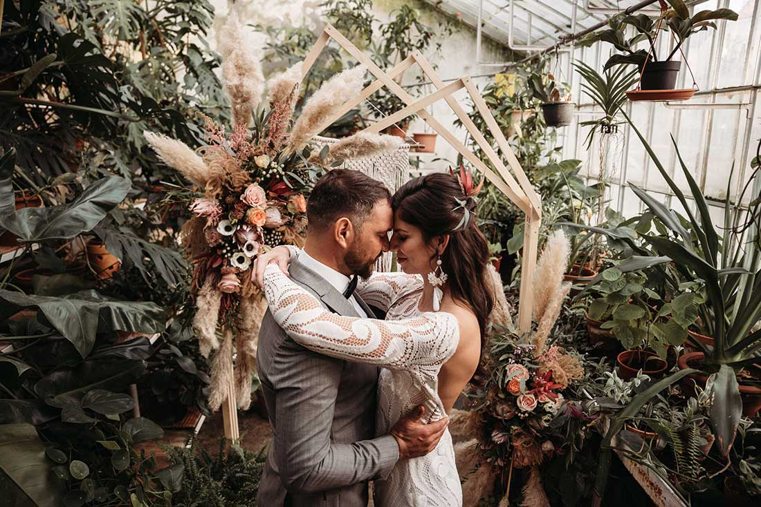 Couple in love say I DO on their boho elopement in Sežana Botanical Greenhouse