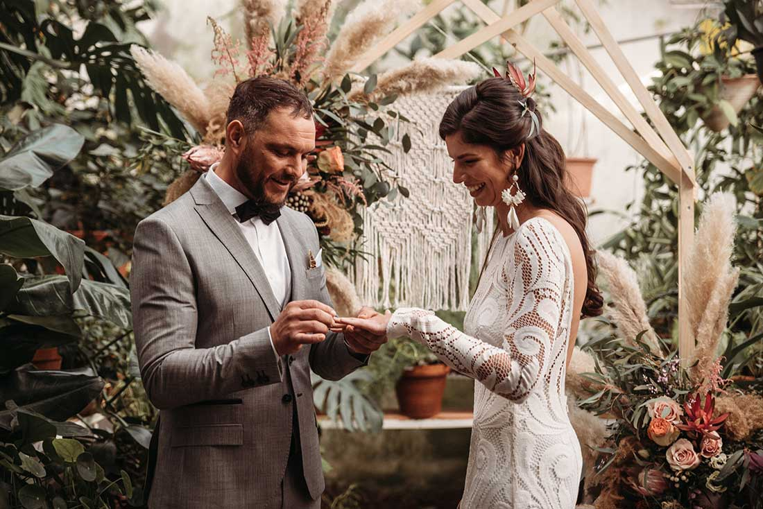 Exchanging the rings during the wedding elopement ceremony in Sežana Botanical Garden