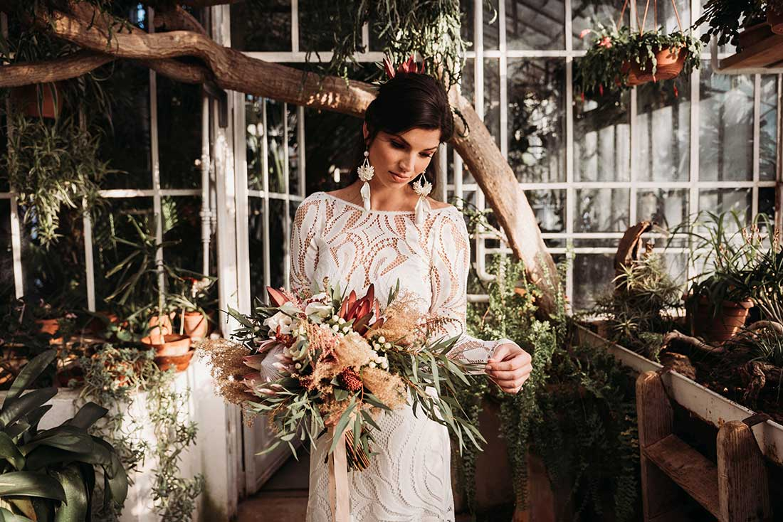 Beautiful lace wedding dress for a wedding in a boho theme.