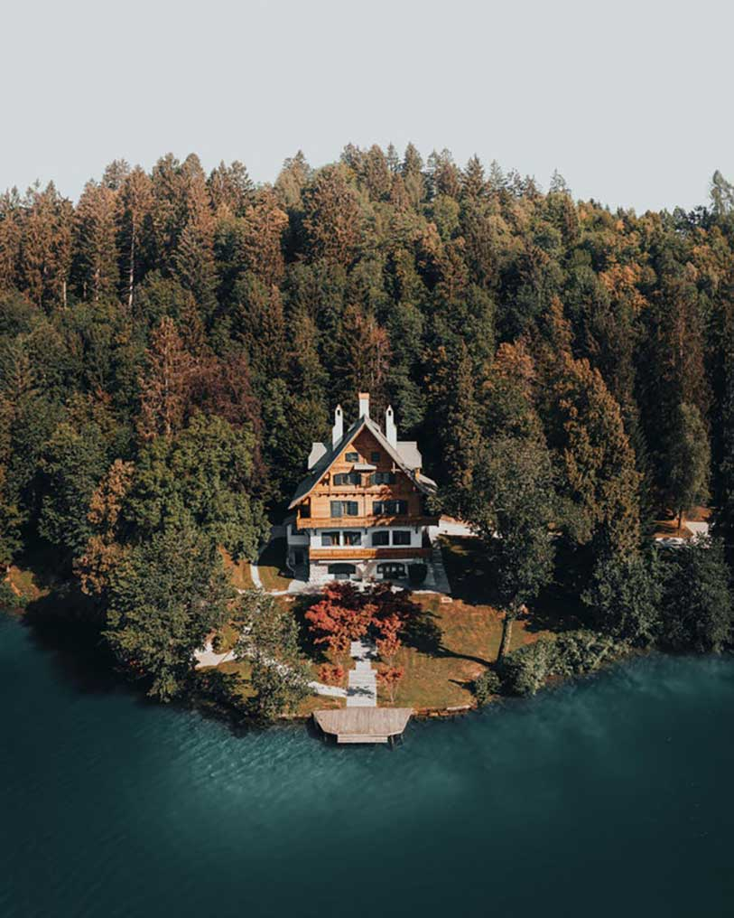Vila Zlatorog, a luxurious country villa with bright green shutters, attracts glances and it can be a perfect venue for a wedding at Lake Bled.