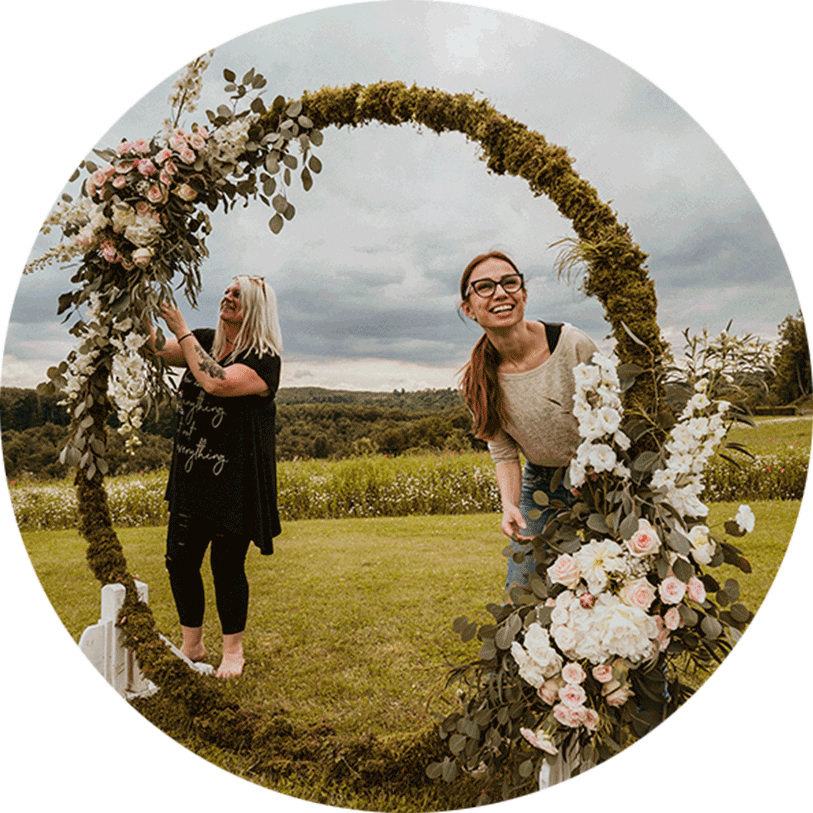 Lake Bled Wedding Planner Petra Starbek with florist make an amazing boho wedding arch with fresh flowers in pastel colors