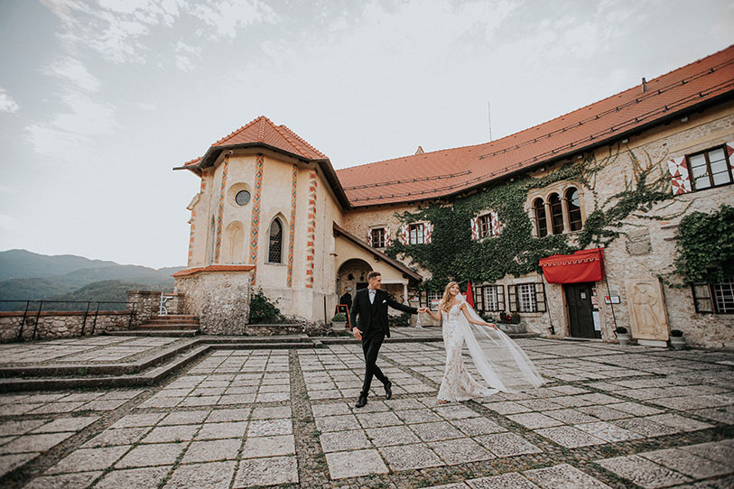 Perfect day for a stylish wedding at Bled Castle under the sky. Bride and Groom at their photoshooting on wedding at Lake Bled.