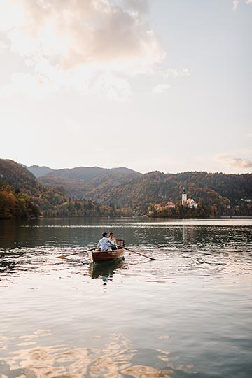 Bride and Groom choose to have fun during exploring the Lake Bled with the boat