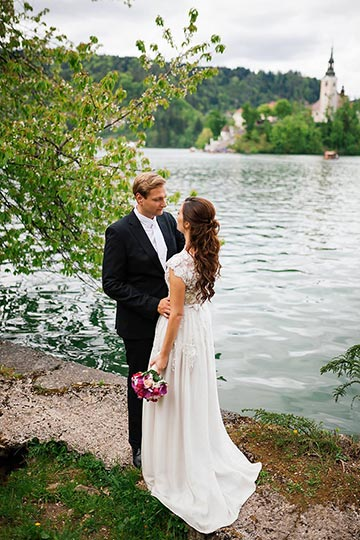 Amazing couple at the vila Bled pier - Bled Wedding