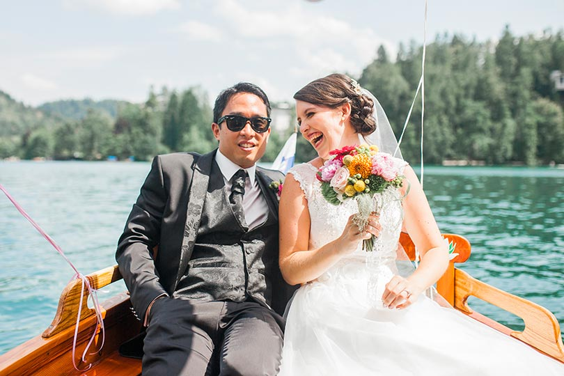 Bride and groom take a boat ride around the lake at their unforgettable wedding at Lake Bled in Slovenia