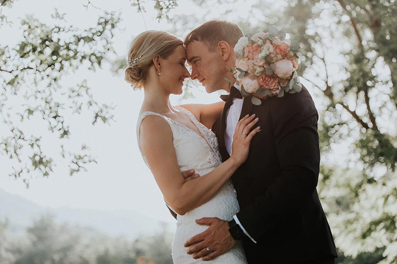Lake Bled wedding photographer during photo shooting at Lake Bled