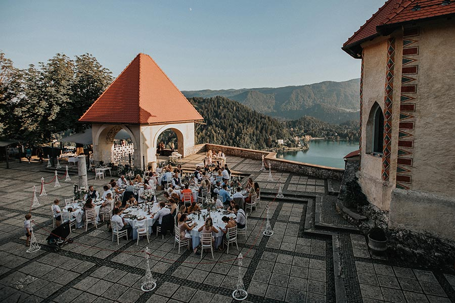 Private table setting at Lake Bled castle terrace for a wedding couple from the United Kingdom