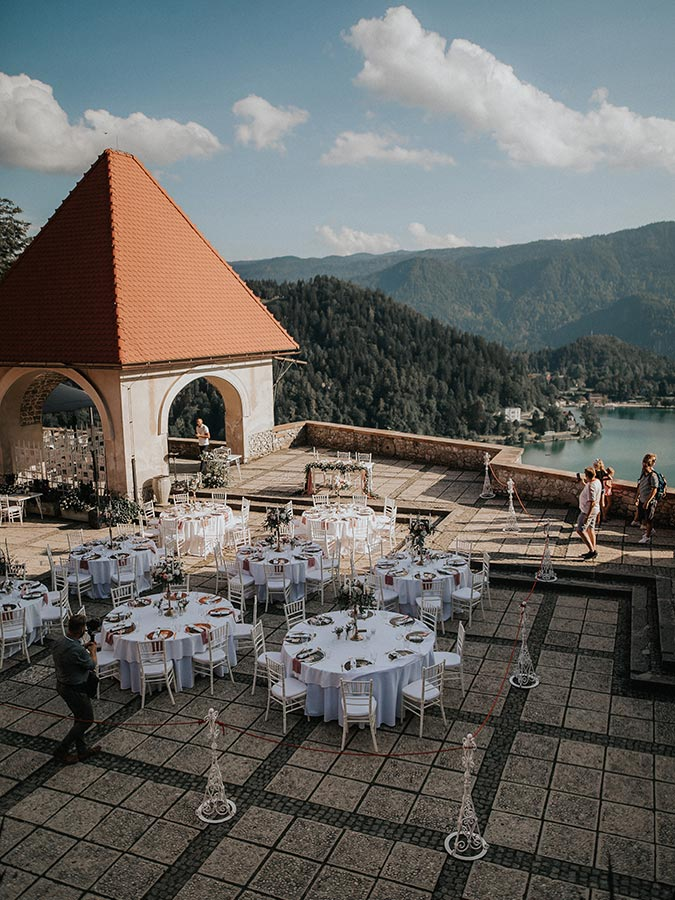 Beautiful Wedding setting at Lake Bled castle wedding, with candles and elegant flowers on a table