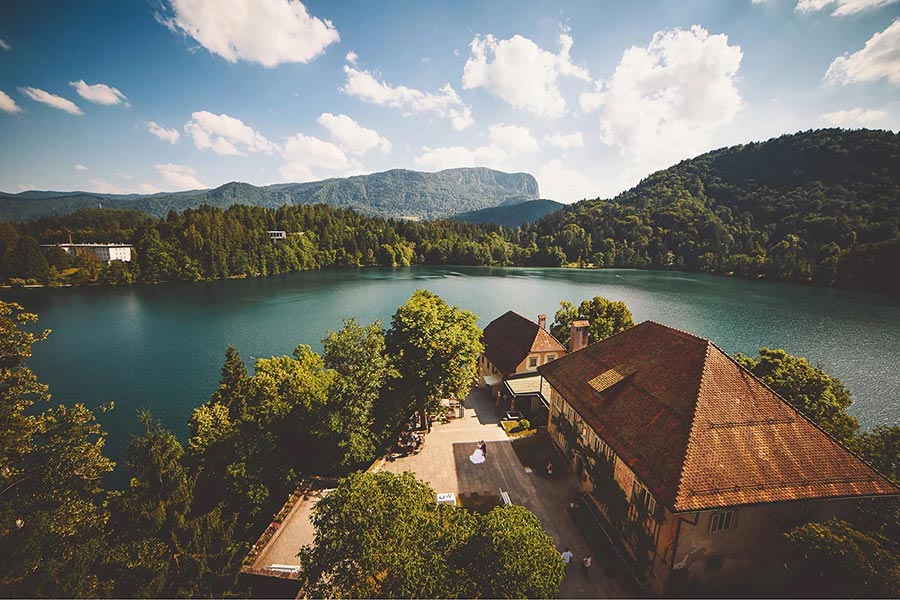 """The sexton's house is located at the Lake Bled island south staircase. The sexton's house and the hermitage are now connected by a building that was constructed in the second half of the 20th century and was named """"Potičnica"""" in 2012."""