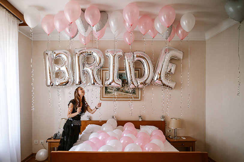 A room full of pink, white and silver balloons and a Bride balloon sign in Vila Bled, Lake Bled.