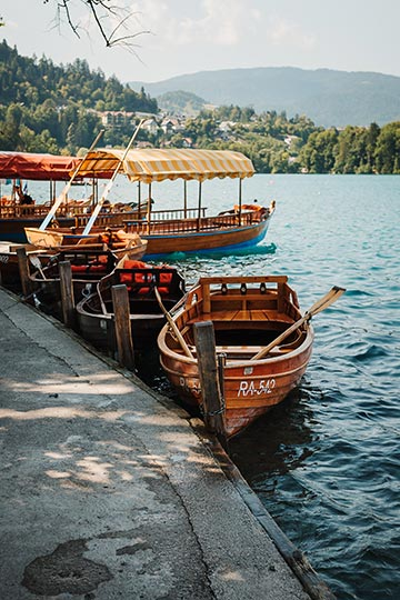 Pletna boats will give you a ride to the Lake Bled Island for your Bled Wedding