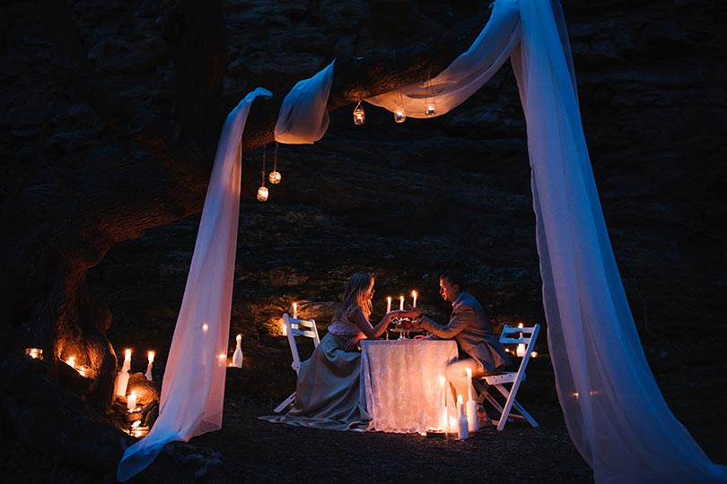 Beautiful Lake Bled proposal during romantic dinner with candles