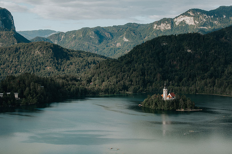 Amazing Lake Bled island stands in the middle of the lake and it is a dreamy location for a destination wedding in Slovenia.