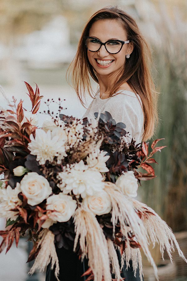 Lake Bled Wedding planner Petra Starbek with big wedding bouquet