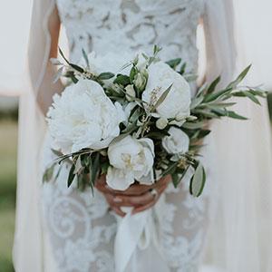 Amazing white green wedding bouquet on destination marriage in Slovenia