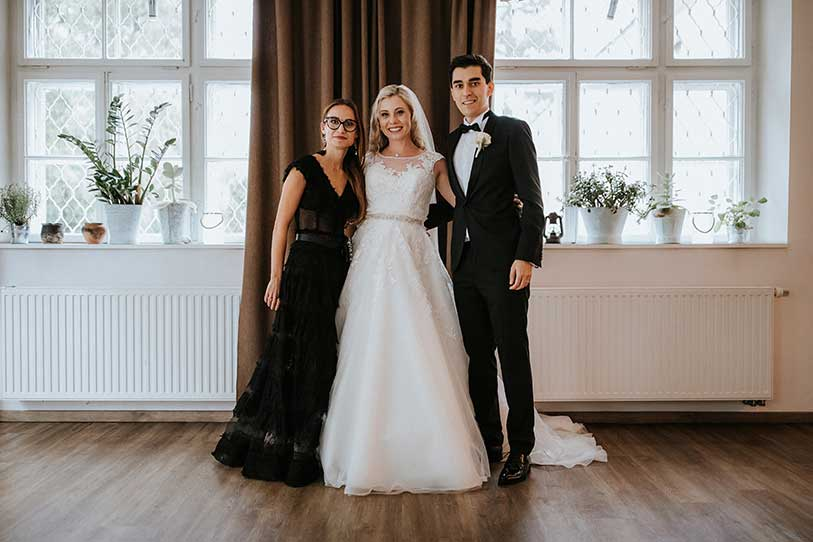 Top Lake Bled Wedding Planner Petra Starbek with her couple