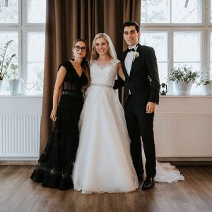 Happy newlyweds with the wedding planner from Lake Bled wedding team