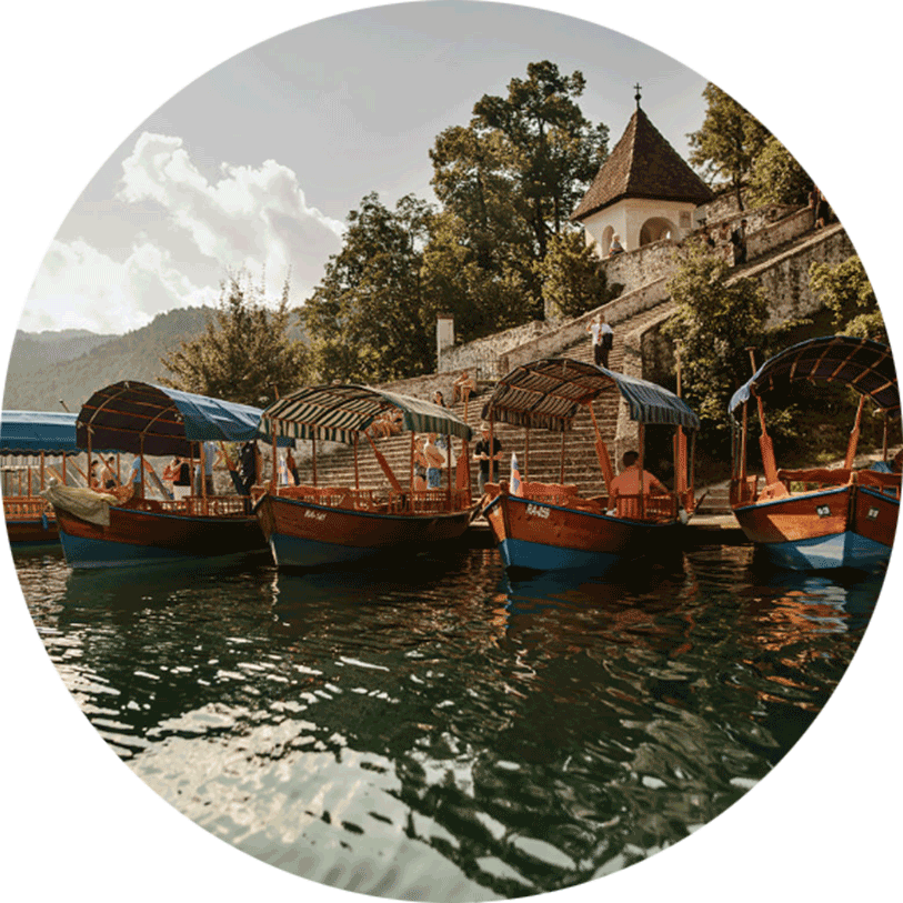 Lake Bled boats called Pletna are standing at the pier at Lake Bled Island.