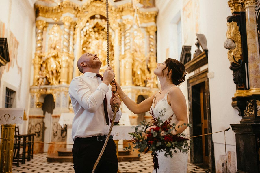 Bride and Groom ring a bell and make a wish because of the traditions which tell - the wish come true if you ring a bell