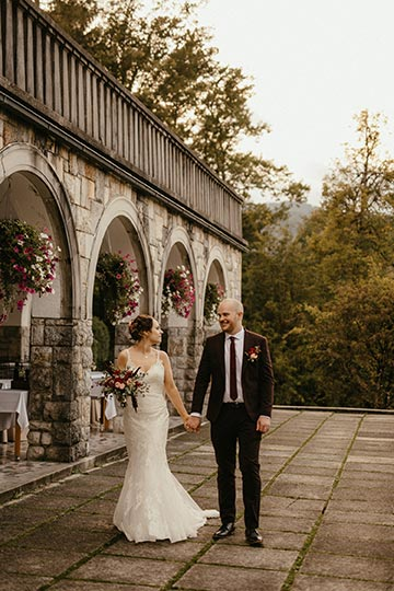 Couple is holding hands on their memorable Bled Wedding