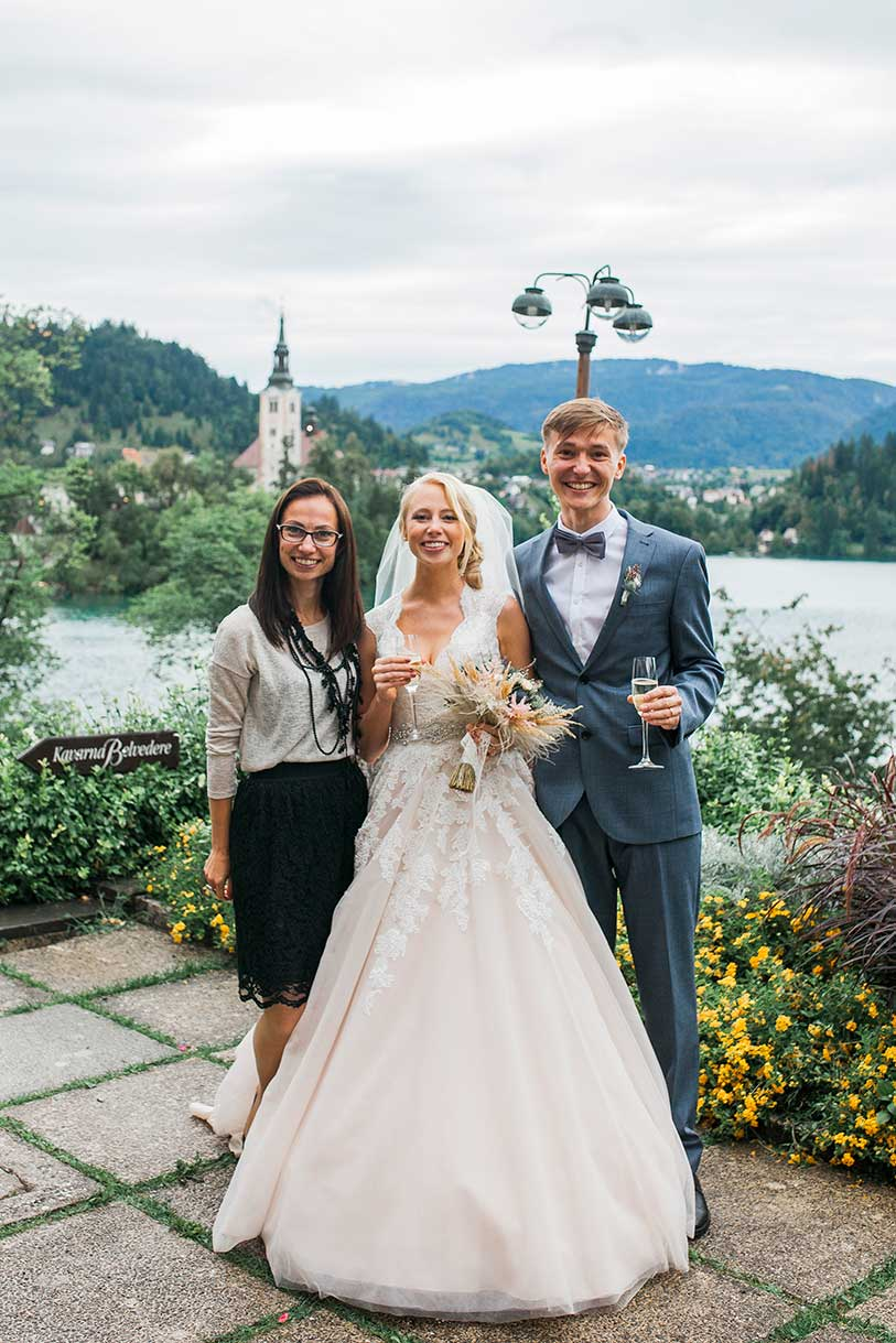 The Best Lake Bled Wedding Planner Petra Starbek with her beautiful couple from England.