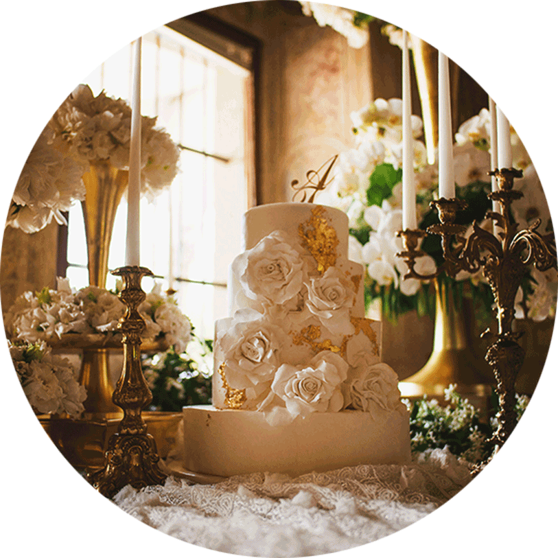 The wedding cake stands in the middle of the table decorated with candles, candelabras, roses petals, and flower arrangements.