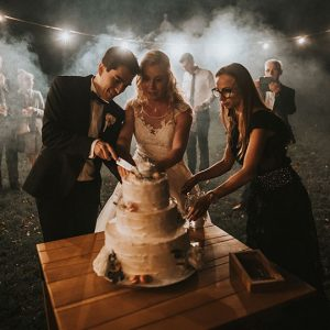 Cutting a wedding cake at vila Bled